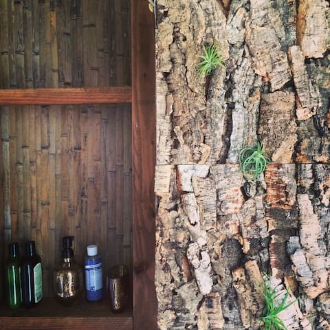 Live with nature as you shower with sustainable cork bark and air plants; organic soaps and shampoos available for use