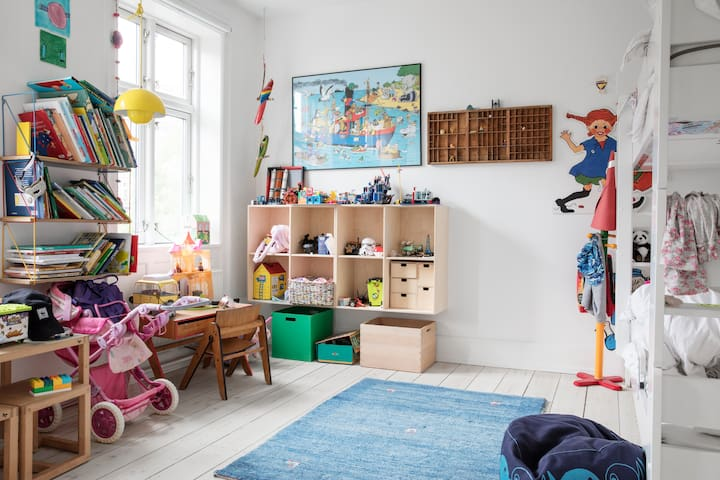 Children's room on the first floor with bunk beds and toys