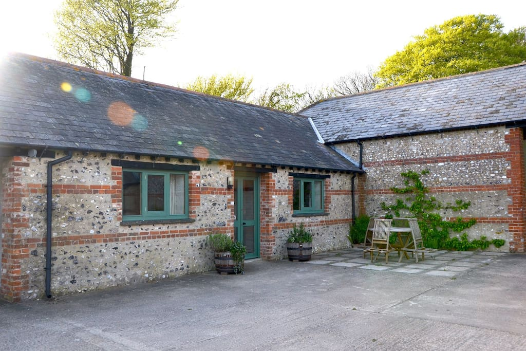 The B&B is within the yard and has an outside seating area for guests...