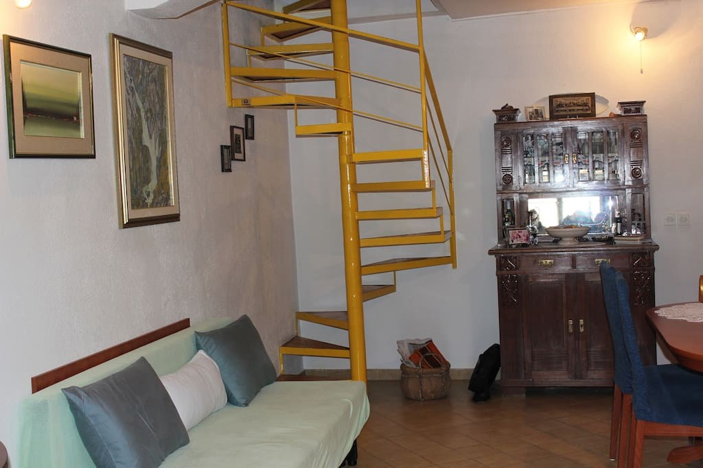 The living room stairs to the upper floor