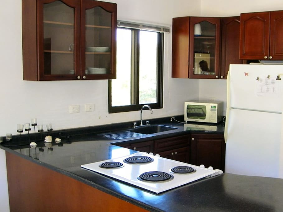 Spacious kitchen with everything needed for home away from home cooking.