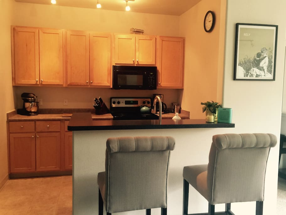 We have a beautiful kitchen with a stainless steal stove and refrigerator. This also includes a microwave, toaster, blender, mixer, and just about anything else you might need to cook in.