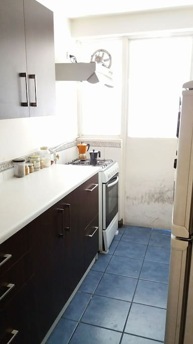 The kitchen, coffee and tea are waiting for you! Outside there is a utility room to do the laundry (3000CLP)