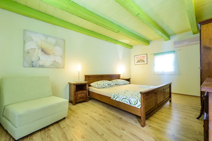 Bedroom with double bed and pull out sofa chair