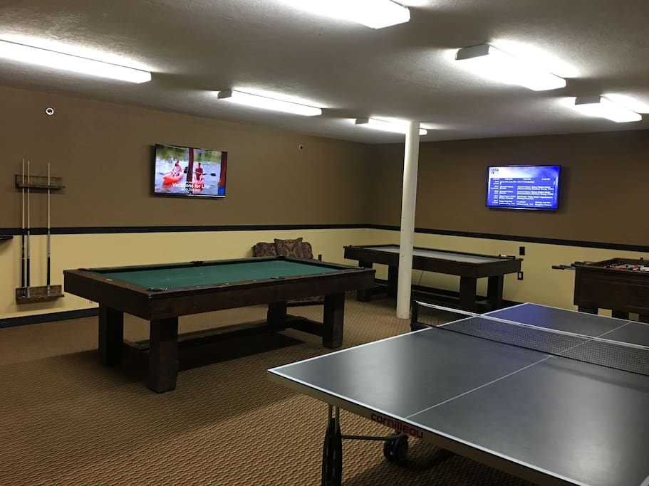 game room with pool, air hockey, foosball, and ping pong