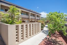 Front exterior of apartment features lush tropical plantings in the quiet 8-unit building.