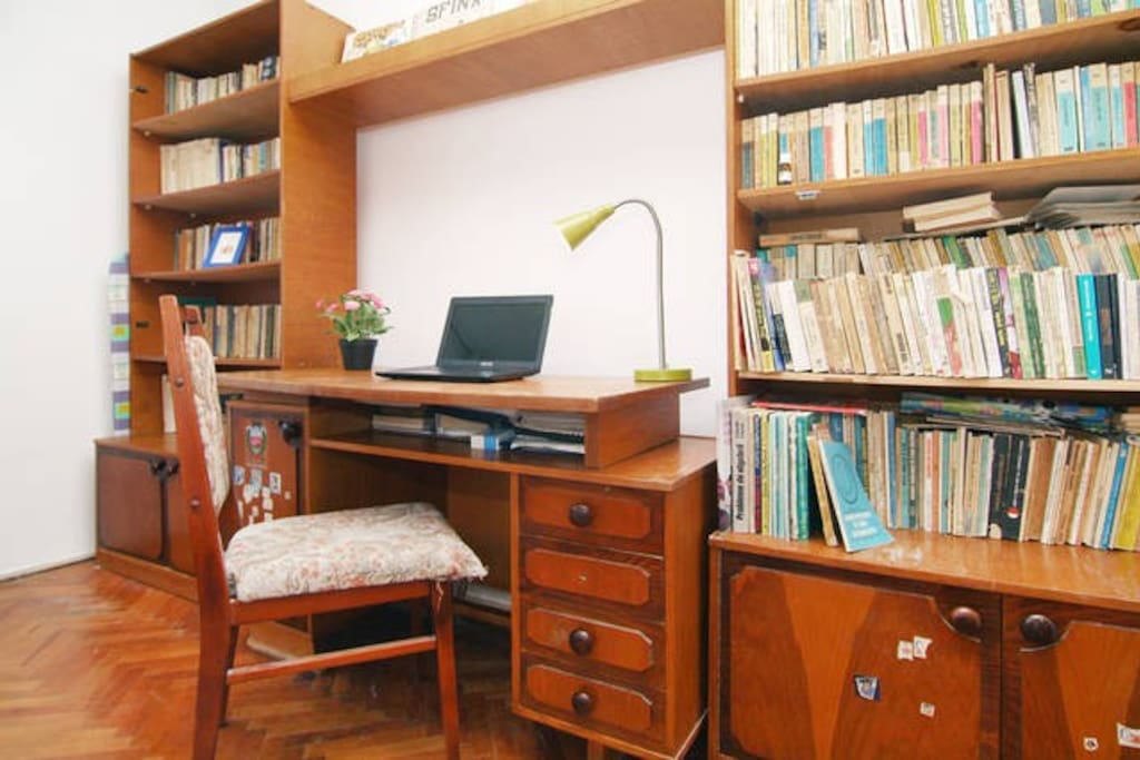 Hardwood desk with a great selection of books and vinils