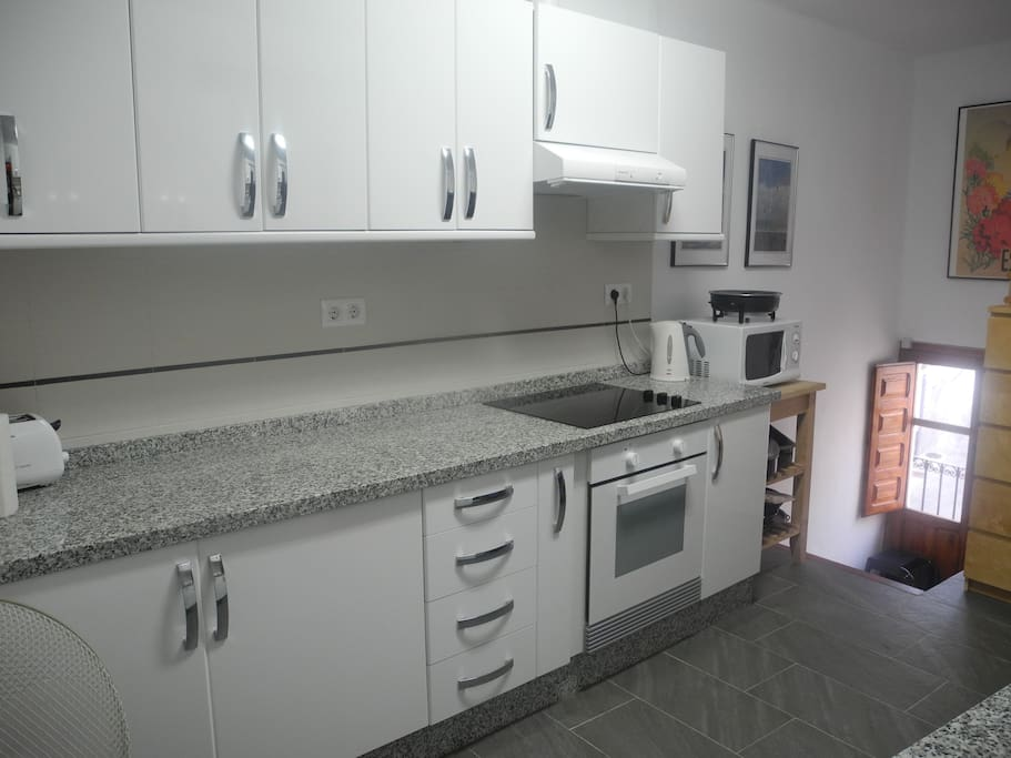 This new kitchen was fitted Spring 2014 - well equipped with all home comforts including dishwasher! An outdoor terrace is located adjacent to the kitchen - gin & tonic a must!