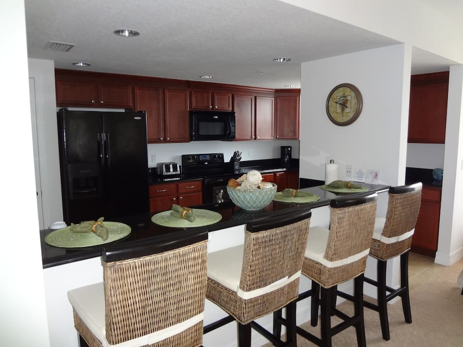 Granite breakfast bar & place to host additional guests.
