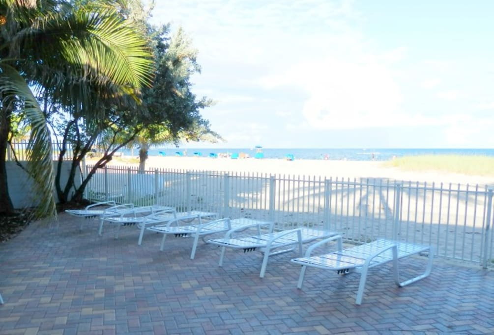 Full beach deck with grills, chaise lounges and plenty of tables and chairs