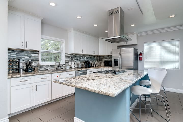 Exquisite kitchen includes amenities such as a Keurig coffee maker, toaster, and blender.