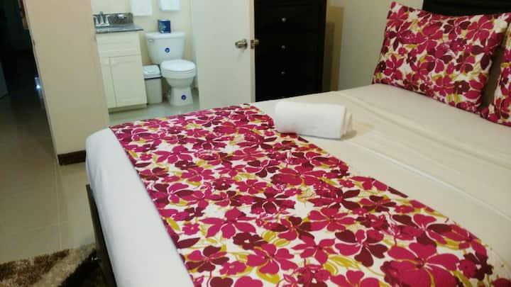 RELAX VILLA - Queen bedroom by Ashley