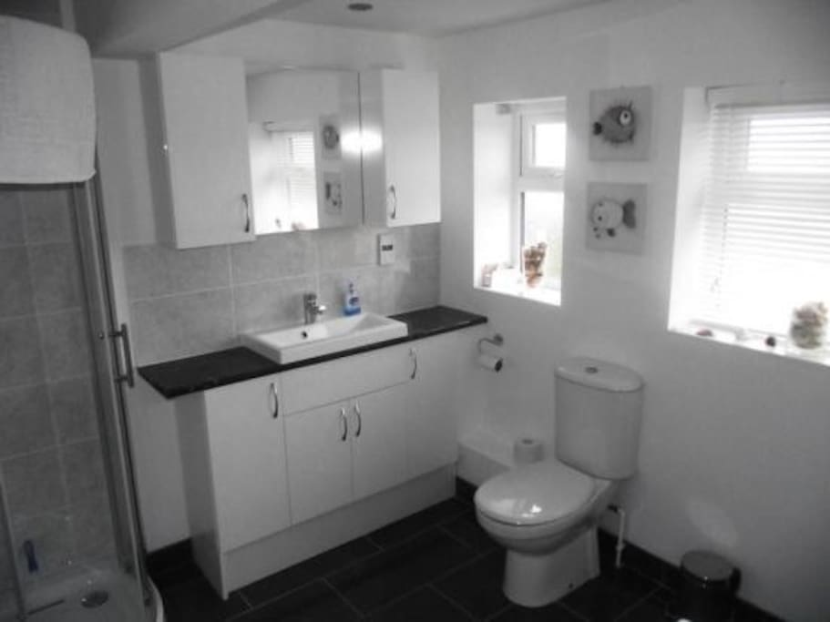 Main bathroom with bath and separate shower