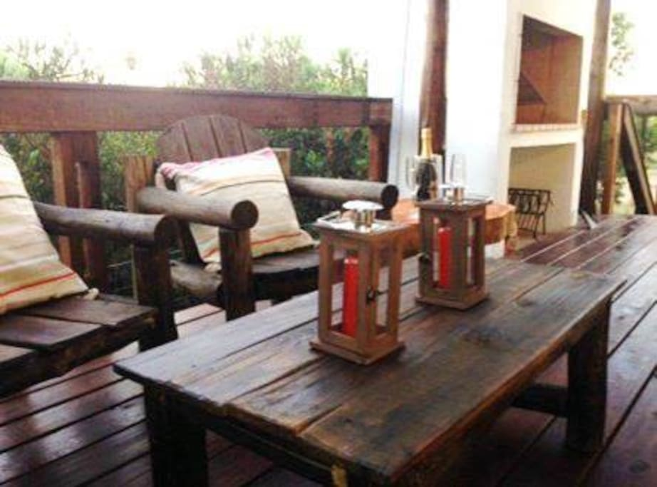 Private deck of one of the two below apartments equipped with parrilla (bbq)