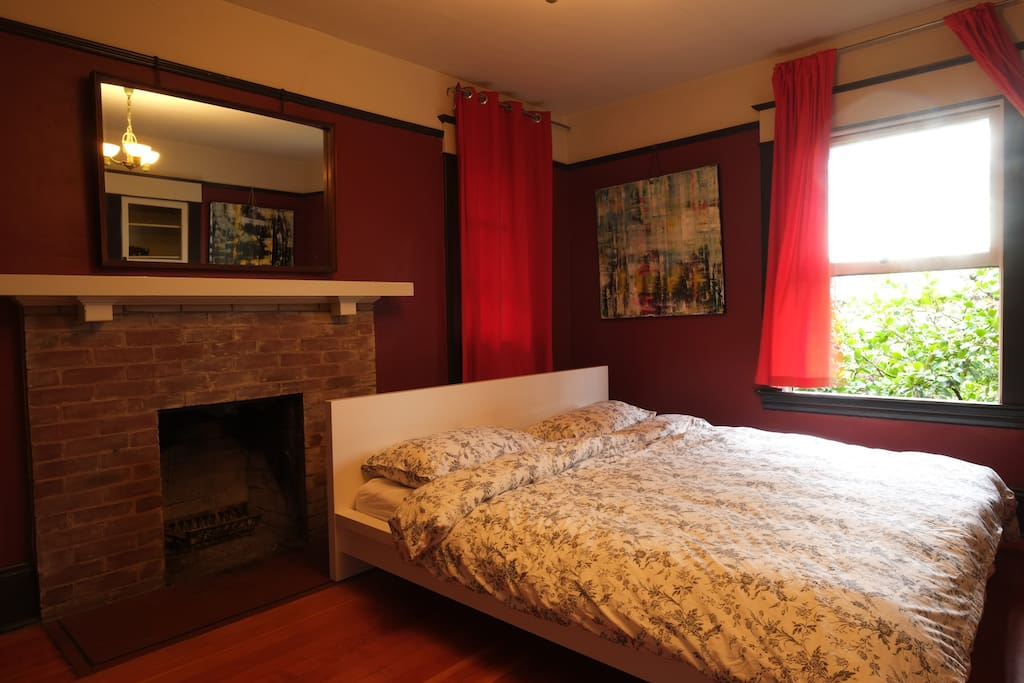 The main bedroom has a king-size Tempurpedic bed and working fireplace
