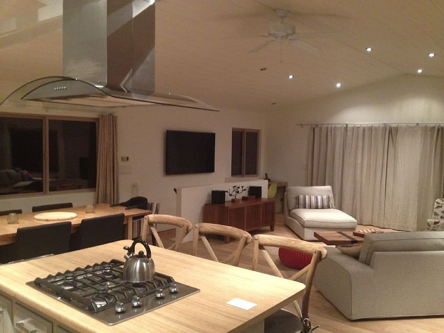Night view: looking from kitchen to the living and dining area.