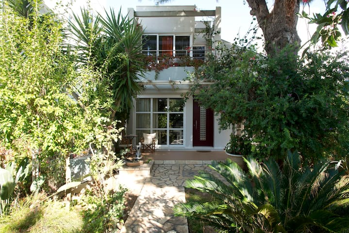 Maisonette with a garden 100m from the beach .