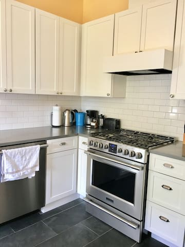 Fully equipped kitchen with gas range stove, coffee maker, toaster oven and all kitchen supplies