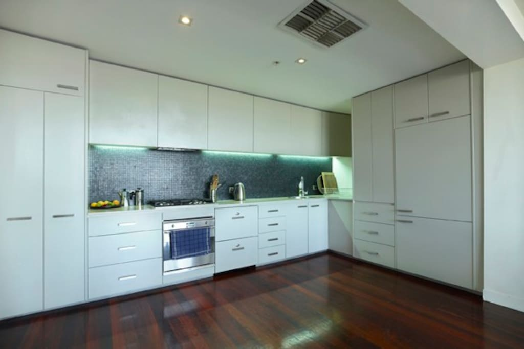 Kitchen integrated with modern fittings and quality cookware.