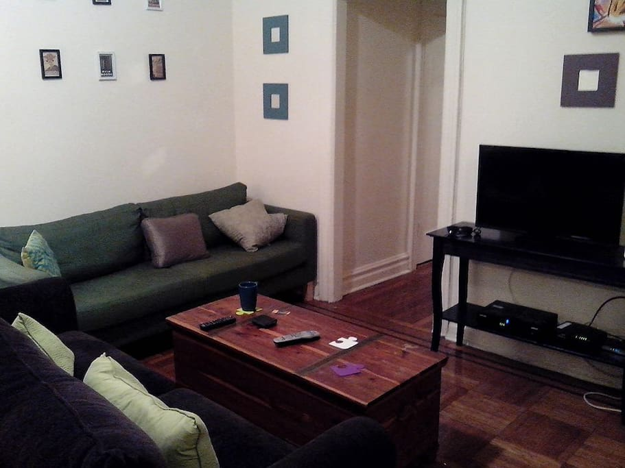 Brown couch folds out to a comfy tempurpedic bed.  Free wifi, Cable.  Private space.  Shared bathroom.