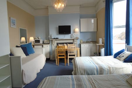 Family en-suite studio with kitchenette. Ground floor. Sleeps 4/5 persons with space for travel cot
