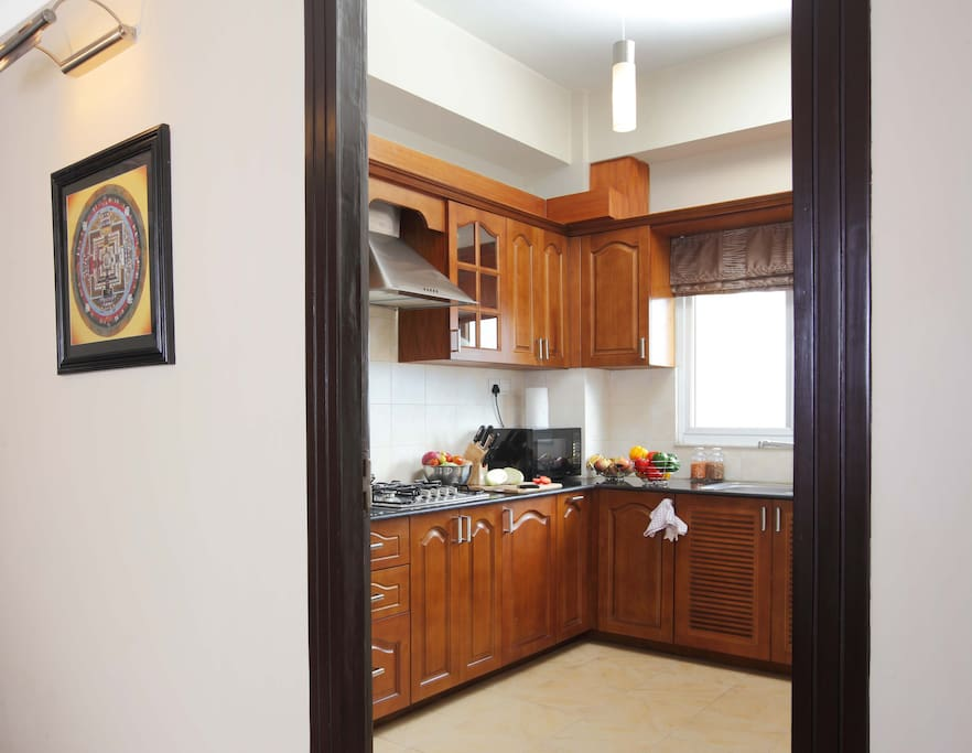 Fully equipped kitchen with Modern Supplies,Two Bedroom Standard Apartment