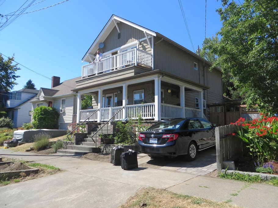 The upstairs duplex features a private side entrance and a balcony.