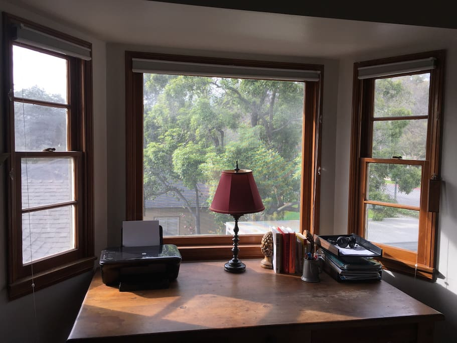 Large desk with beautiful treetop views.