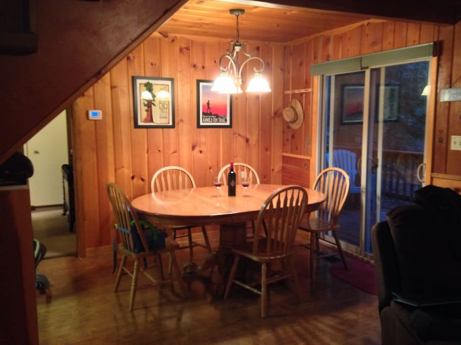 Dining room with solid oak table. We have a couple extra chairs if needed.