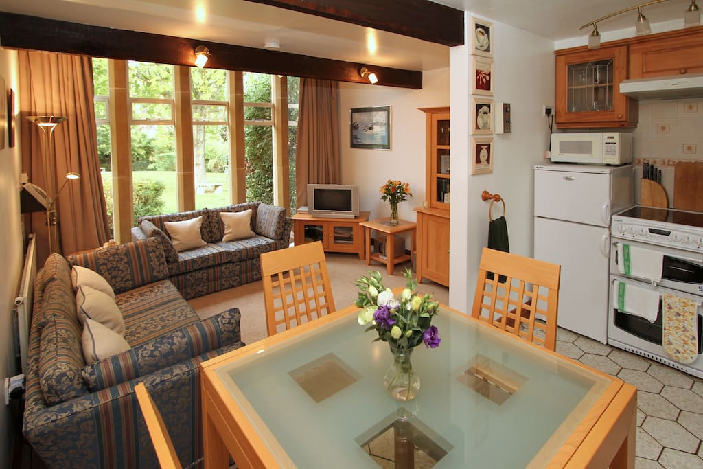 Very wide angle view of the open plan living area on the ground floor.
