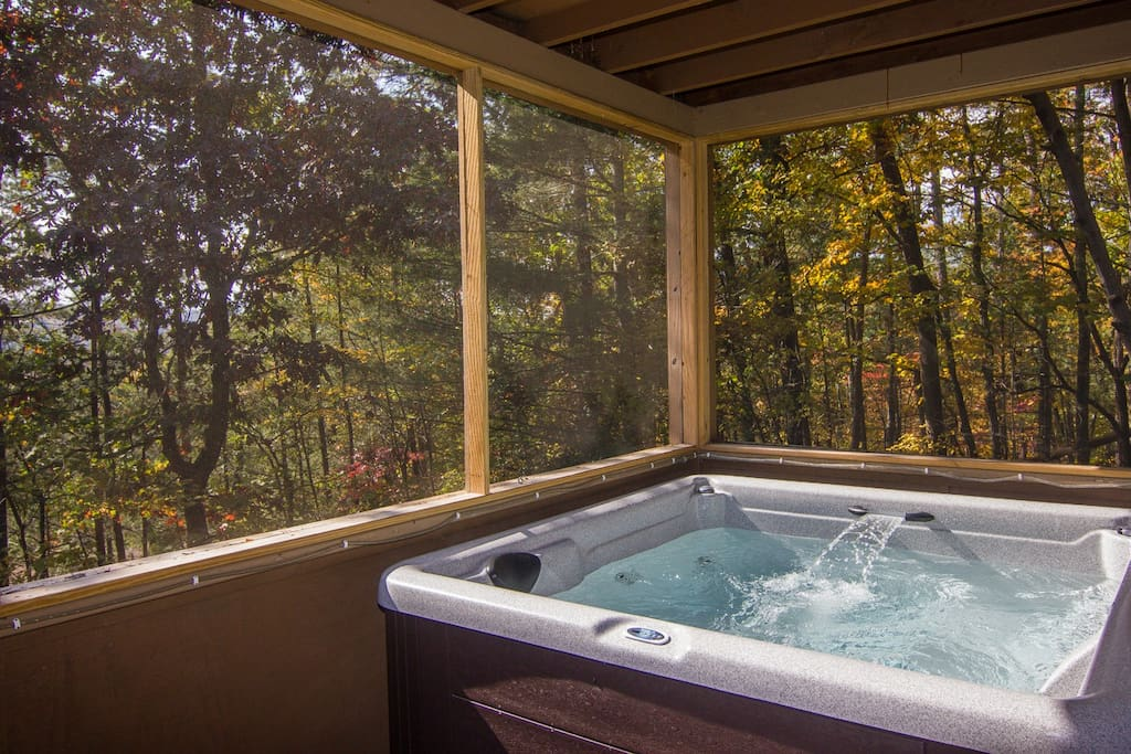 The hot tub is on a screened porch so bugs won't be a bother