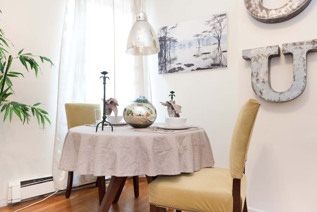 Table for two, who needs more? The sliver theme which makes the room elegant is carried  through in the fixtures that include the hanging lamp, vase and art work.