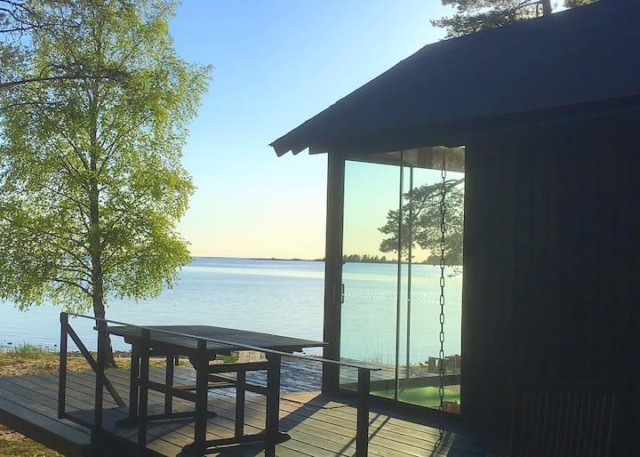 Nice cottage with own beach, wooden, big Sauna!