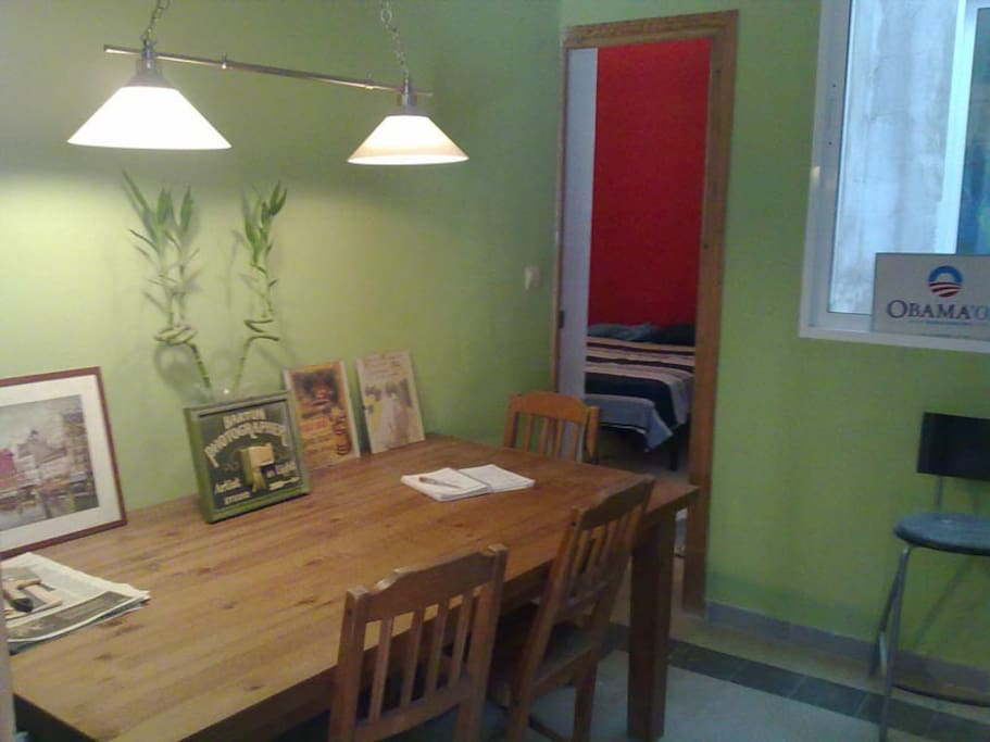Welcome! You enter in the central room with the big dinner table. In the back: the bed room (situation  2013 - picture for the real colors)