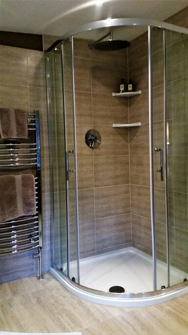 Ensuite bathroom with separate shower and corner bath