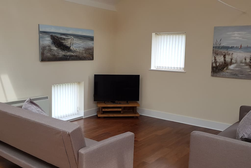 """Living room with 49"""" 4K TV"""