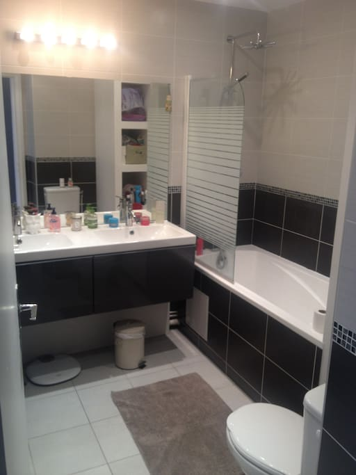 Newly renovated bathroon with bath and shower.