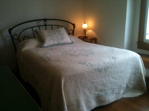 Large elegant room receives lovely morning light
