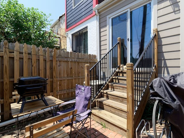 Outdoor patio (shared) with picnic table. Guests can request use of grill.
