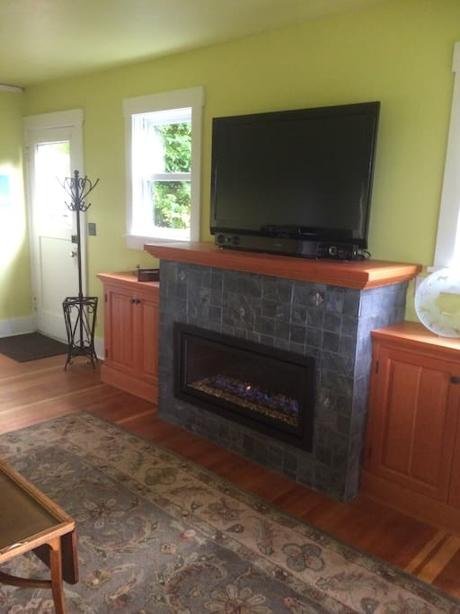 Living room also features a gas fireplace and TV.