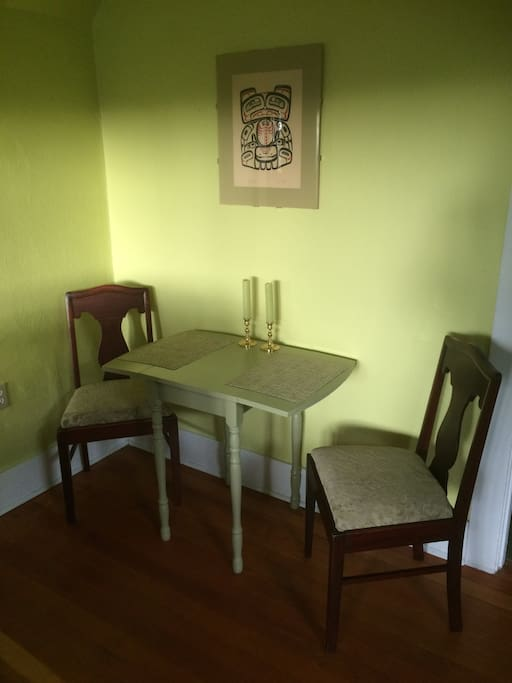 In the back corner of the living room is a small eating area.