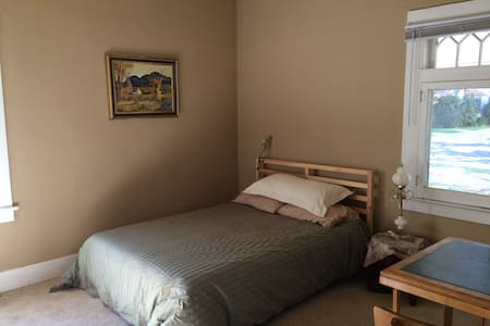 Cute Bedroom in Charming Downtown