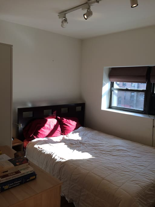 Sunny and airy bedroom (2)