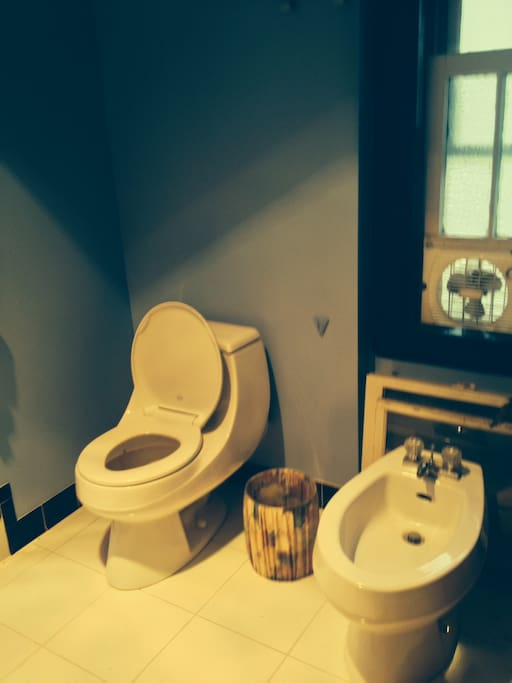 Toilet and bidet in the second floor, newly remodeled, bathroom.