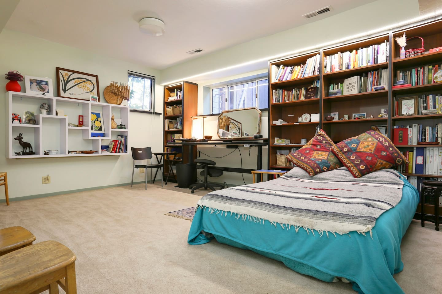 Spacious book filled room that offers a calm and restful space. The desk adjusts to standing height or seating.