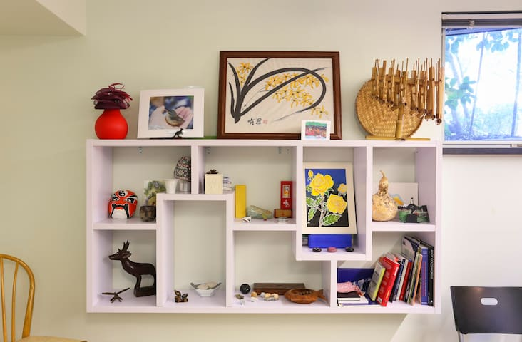 Shelves with original art and collectibles from around the world decorate the Zen room