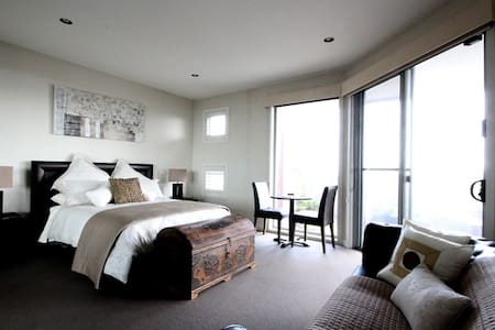 The Esplanade Bed & Breakfast's 'Seaview Suite' Large studio room, Comfortable lounge,  Dining table & chairs Impeccably clean and modern Queen bed, top quality linen Superbly appointed private bathroom Gourmet cooked breakfast(s) Free WiFi Spa & Gym