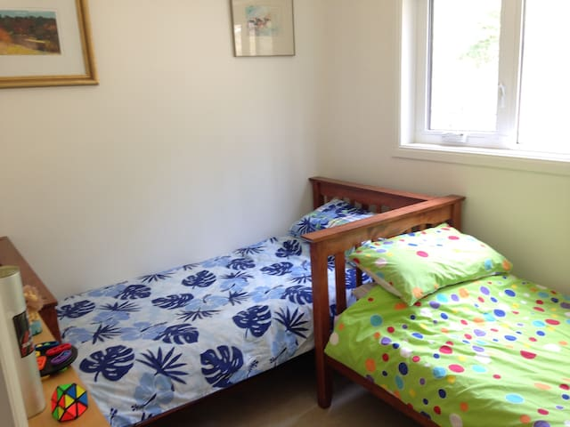 2 single beds in separate bedroom