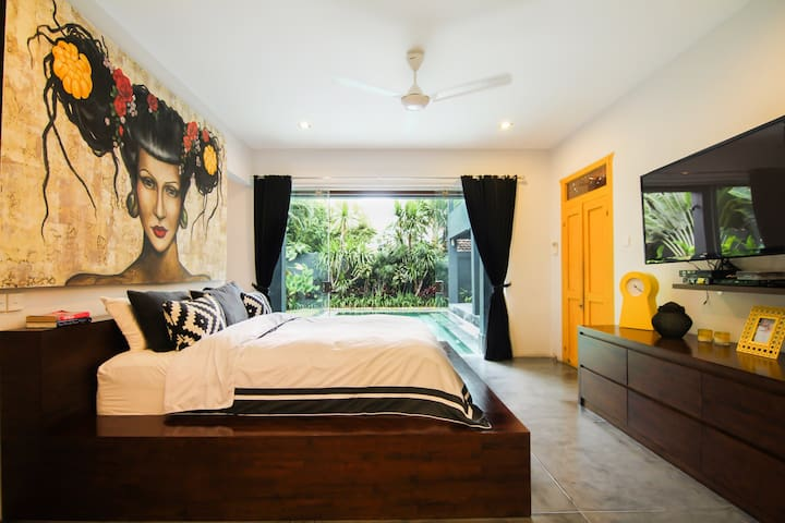 Ground floor master bedroom with direct pool access, walk in dressing room/wardrobe and huge ensuite