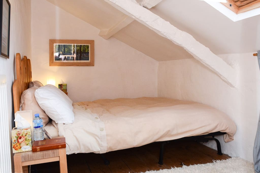 This double bedroom is cosy (which means it is small) and full of light from the Velux window, Mind your head.